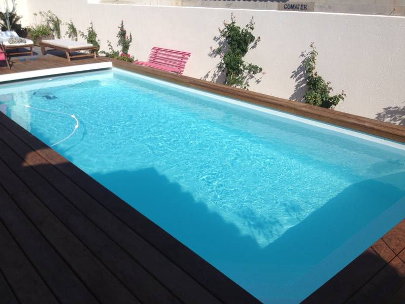 Magasin d 39 accessoires de piscine g menos oz o for Construction piscine hiver